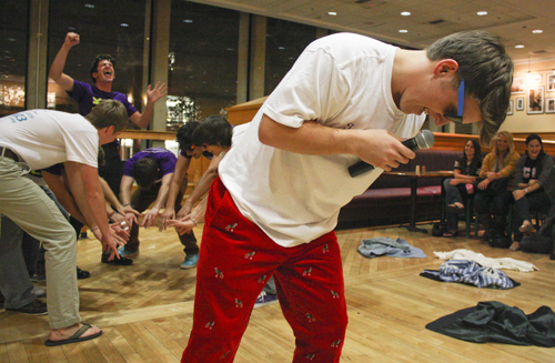 """Sophomore Eric Arpert (front) lip syncs """"Shout"""" by the Isley Brothers with fellow Pi Kappa Alpha members at a philanthropy event hosted by Sigma Kappa. Ashley-Lynn Goldstein/Hatchet Photographer"""