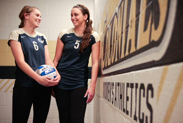 Sophomore Taylor Knox, left, and her sister, senior MacKenzie Knox, right, both compete for GW. The two always wanted to play volleyball together, and say their connection provides extra comfort on the court.
