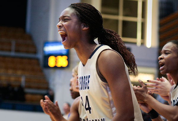 Sophomore forward Chelisa Painter cheers as the Colonials pull ahead Wednesday.