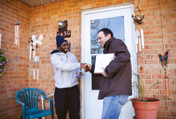 Alumnus Max Skolnik, right, greets Ward 4 resident Gregory Alston as he canvasses Saturday afternoon in the Takoma neighborhood for a seat on the D.C. Council.