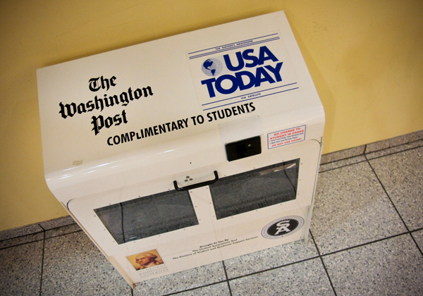 An old newspaper stand, which sits at the H Street entrance of the Marvin Center, will be temporarily refilled because of Student Association efforts to fund the return of free copies of The New York Times to campus.