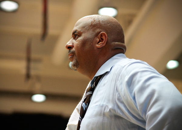 Then-head coach Mike Bozeman watches as his team competes against Morgan State Nov. 16, the first time the Colonials would fall this season. Bozeman was relieved from his post as head coach Monday.