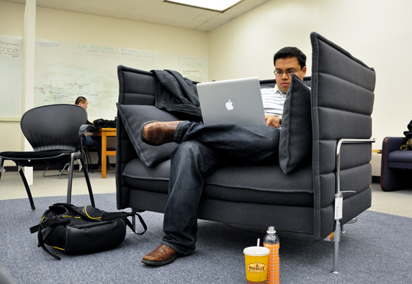 Graduate student Md Ehraz Refayet sits in a sample piece of furniture that may be added to Gelman Library during renovations that will begin this summer and end in 2014.