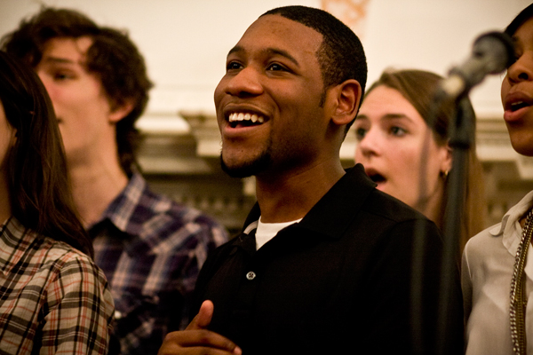 Ryan Thornton performs with the GW Vibes a capella group Saturday at the second-annual International Women's Day Banquet at Post Hall.