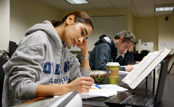 Dalia Abu-Eid and Kevin Meehan, both third-year law students, study Sunday for exams in a Stuart Hall computer lab. The GW Law School's academic and wellness support services for students will ramp up next year.