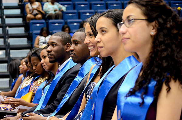 Graduates listen to remarks from Michael Tapscott, the leader of the Multicultural Student Services Center, who called for graduates to celebrate the connections and friendships they made at GW.