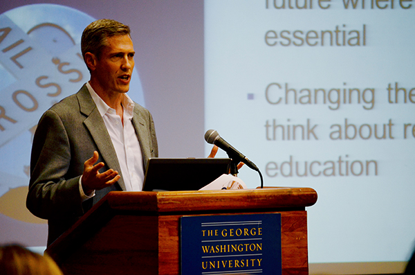 "Anthropology department chair Brian Richmond, who also chairs the strategic plan group on innovation, pitches an idea for academic restructuring at a May 8 town hall. Richmond said a one-college model would remove ""real barriers"" students face when trying to study in multiple fields."
