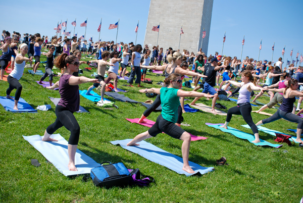 Mats covered the National Mall Saturday as thousands attended Yoga on the Mall, the largest event of the D.C. Yoga Week.