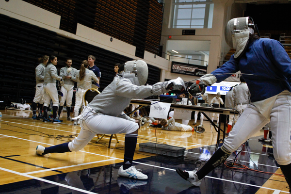 Senior Brittany Jones faces off against a University of Pittsburgh opponent at the Southern Atlantic Conference fencing tournament Sunday. The tournament, which took place in the Smith Center, was the first fencing competition hosted by GW in eight years.