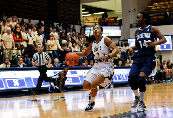 "Sophomore guard Chakecia Miller avoids a Georgetown defender as she drives to the basket on one of GW""s few fast-break opportunities during Saturday's game."