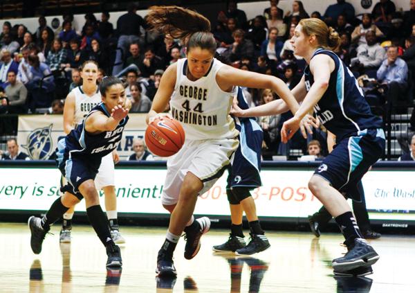 Graduate student center Sara Mostafa charges down the court, avoiding a Rams defensive team as she heads to the basket.