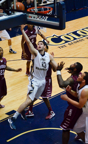 Freshman forward Patricio Garino lays it in during Wednesday night's game. The Colonials snapped a two-game losing streak by defeating the Fordham Rams.