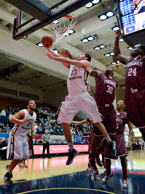 Freshman forward Kevin Larsen is engulfed by Fordham defenders after grabbing one of his five rebounds on the night. Larsen scored a career-high 15 points on the night.