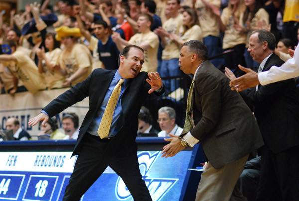 Kevin Sutton, right, will leave head coach Mike Lonergan's coaching staff to head to Georgetown. Hatchet File Photo
