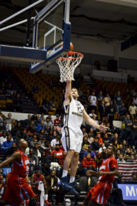 Sophomore forward Patricio Garino dunks in a game earlier this season. He has continued to be one of GW's most explosive players since A-10 play began. Hatchet File Photo