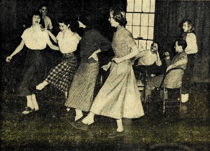 Four freshmen women practice dancing in preparation for the all-U follies, Photo courtesy of the George Washington University Archives.