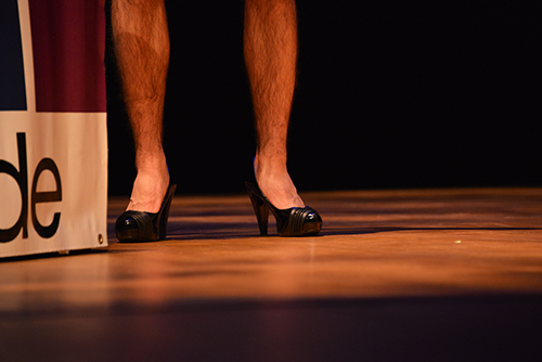 A fraternity member performed in heels in Allied in Greek – a drag competition – on Monday. Sam Johnson | Hatchet Photographer