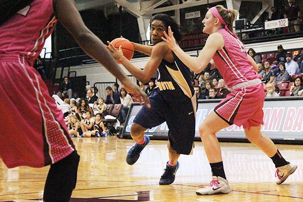 Caira Washington drives into the paint in a game last season. Washington had 23 points in GW's win over Dayton Sunday as the Colonials snapped the Flyers' 31-game home winning streak. Hatchet File Photo.