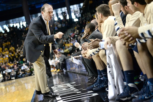 Head coach Mike Lonergan talks to his bench during the A-10 Tournament. Hatchet File Photo