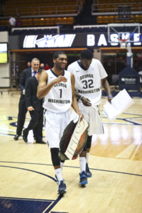 Maurice Creek and Isaiah Armwood exit the Smith Center court after the Colonials defeat St. Joseph's. Hatchet File Photo