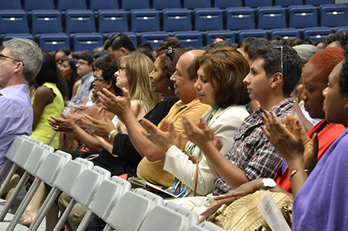 Families clap during the multicultural celebration Thursday. Kendall Payne | Hatchet Staff Photographer