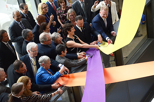 Faculty in the Milken Institute School of Public Health cut ribbons to officially open the school's new building on Washington Circle Thursday. Katie Causey | Hatchet Staff Photographer