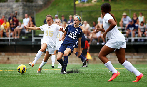 Junior midfielder Nicole Belfonti fights for possession against an Old Dominion player. Cameron Lancaster |  Photo Editor