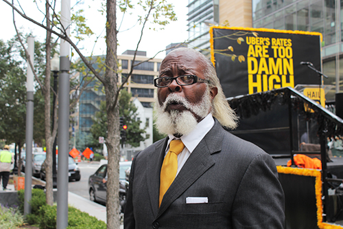 Jimmy McMillan, the founder of New York's The Rent is Too Damn High party, took to D.C.'s streets to promote an Uber competitor. Charlie Lee | Hatchet Photographer