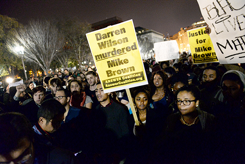 Students from Howard, American and Georgetown Universities poured in front of the White House in protest of a grand jury decision to not bring charges against police officer Darren Wilson for the shooting of Michael Brown in Ferguson, Mo. this past August. Samuel Klein | Senior Photo Editor