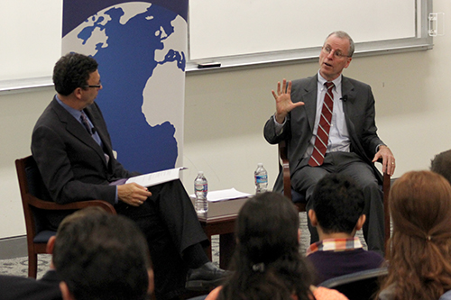 School of Media and Public Affairs Director Frank Sesno (left) speaks with