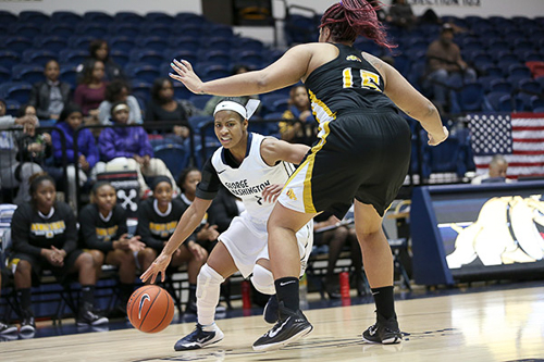 Senior Chakecia Miller drives past a Bowie State defender on Wednesday. Miller scored 10 points in GW's home opener win. File Photo by Dan Rich | Hatchet Photographer