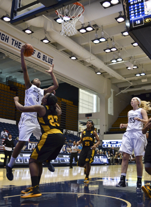 Freshman forward Caira Washington jumps for a lay up in GW's 89-51 win over Grambling State on Monday afternoon. Washington recorded her second double-double of the season with 17 points and 13 rebounds. Aly Kruse | Hatchet Staff Photographer