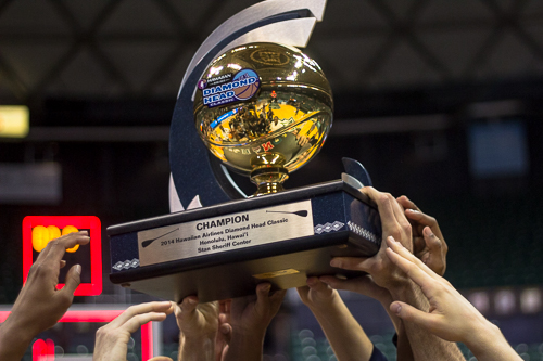 Members of the men's basketball team lift the Diamond Head Classic championship trophy after they defeated No. 11 Wichita State 60-54. Nora Princiotti | Hatchet Staff Photographer