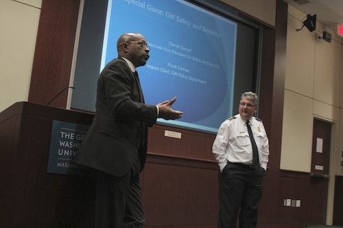 Senior Associate Vice President for Safety and Security Darrell Darnell, left, and University Police Department Interim Chief Frank Demes speak with Residence Hall Association members Monday night about campus safety resources for students. Charlie Lee | Hatchet Staff Photographer