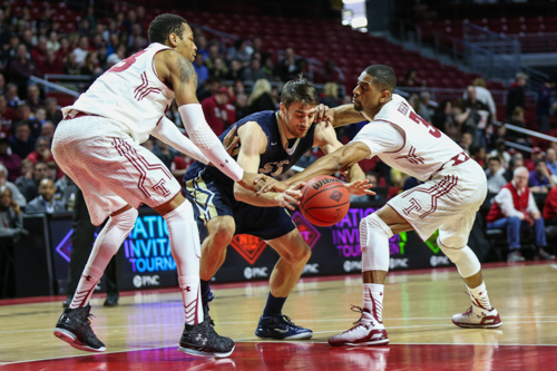 Senior John Kopriva struggles for the ball between two Temple defenders. Kopriva played his final game for the men's basketball team Sunday as No. 5 seed GW fell to No. 1 seed Temple in the second round of the NIT. Dan Rich | Hatchet Photographer