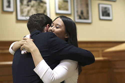 Junior Andie Dowd hugs presidential candidate Ben Pryde after the presidential results were announced. Dowd won this year's election with with 2,659 votes in a three-candidate field. Desiree Halpern | Contributing Photo Editor