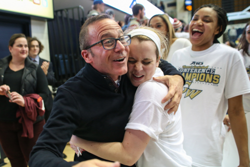 Sophomore Shannon Cranshaw hugs athletic director Patrick Nero in celebration of their championship.