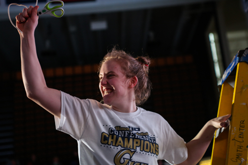 Sophomore Hannah Schaible reacts to cutting down the net.