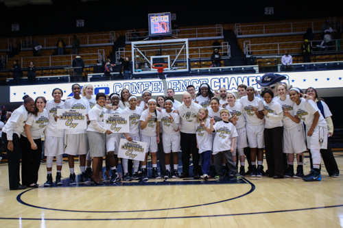 The entire Colonials team and staff pose for a photo.