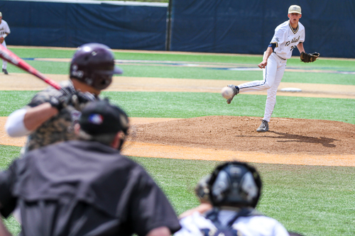 Junior Jacob Williams throws a pitch during GW's game against Fordham. Williams started the game and pitched 7 innings of one-run ball and got a no-decision. Zach Montellaro | Hatchet Staff Photographer