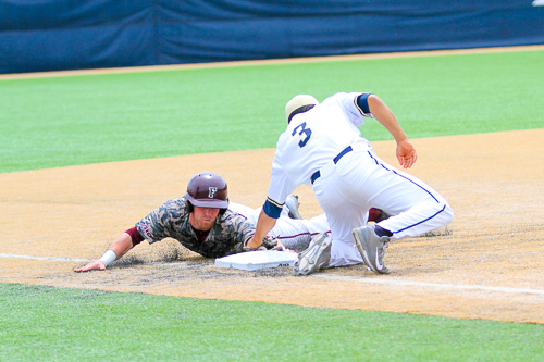 Sophomore Eli Kashi tags out a Fordham runner trying to steal third base. The Colonials would defeat the Rams 2-1. Zach Montellaro | Hatchet Staff Photographer
