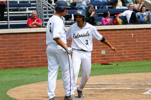 Sophomore Eli Kashi celebrates scoring the go-ahead run in the bottom on the eighth. GW won the third game in the series with Fordham. Zach Montellaro | Hatchet Staff Photographer