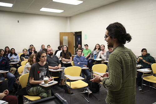 Cavan Kharrazian spoke Wednesday at the Progressive Student Union's forum on the future of the University's dining program. Dan Rich | Hatchet Photographer