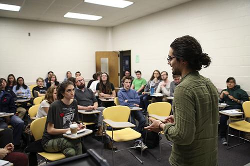 Cavan Kharrazian spoke Wednesday at the Progressive Student Union's forum on the future of the University's dining program. Dan Rich | Hatchet Photographer