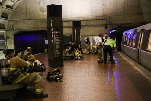 Firefighters waited on the platform of the Foggy Bottom Metro station. Dan Rich | Contributing Photo Editor