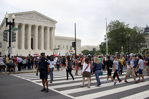 Hundreds of people flocked to the front of the Supreme Court Friday morning to celebrate the decision.