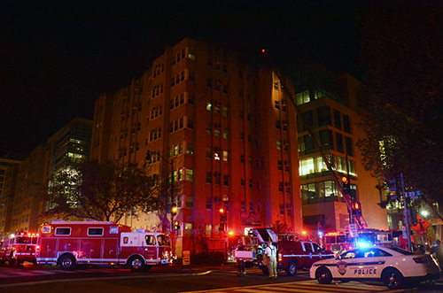 Students in Fulbright Hall were evacuated early Tuesday morning because of a fire on the building's roof. Katie Causey | Photo Editor
