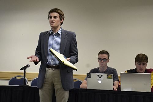 Chris Evans, the Student Associations director of health and wellness, discussed GW Listens, at the SA Senate meeting Oct. 12. The University's first peer support hotline is slated to begin next fall. Camille Ramasastry   Hatchet Photographer