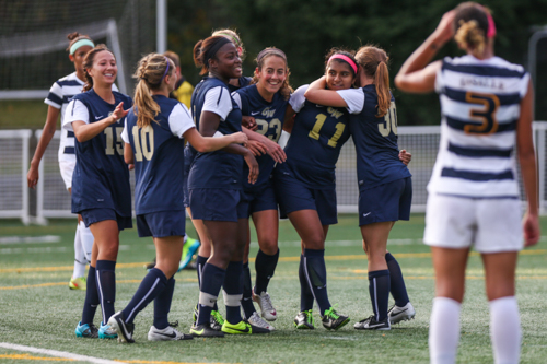 Freshman Sofia Pavon (No. 11) celebrates her game-winning penalty kick which gave the Colonials the win 2-1 against La Salle Thursday. Dan Rich | Contributing Photo Editor