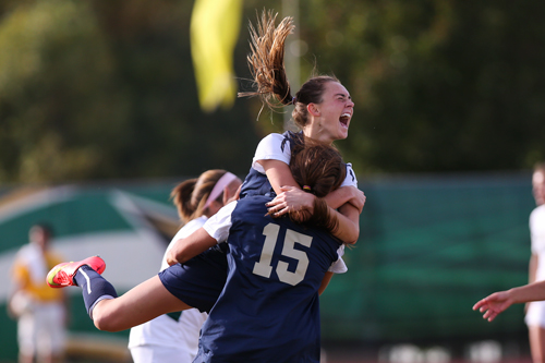 Junior MacKenzie Cowley celebrates after scoring the game winning goal in overtime against George Mason. Dan Rich   Contributing Photo Editor
